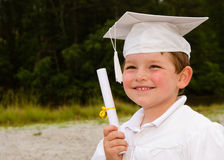 Young boy with cap and gown Stock Photo