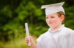 Young boy with cap and gown Royalty Free Stock Photo
