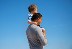 Young Boy Carried by His Father Stock Image