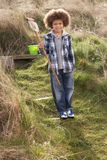 Young Boy Carrying Fishing Net At Seaside Royalty Free Stock Images