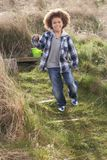 Young Boy Carrying Fishing Net At Seaside Royalty Free Stock Image