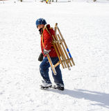 Young boy carrying his sledge in snow Royalty Free Stock Image