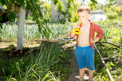 Young boy carrying a spade Royalty Free Stock Image