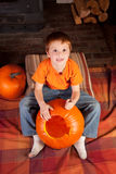 Young boy carving pumkins Royalty Free Stock Photos
