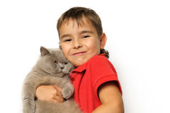 Young boy with cat Stock Images