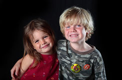 Young boy celebrates his birthday with sister. A young boy and girl celebrate the older boys sixth birthday and pose for a photo Royalty Free Stock Photo