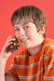 Young boy on cell phone vertic. Shot of a young boy on cell phone vertical Royalty Free Stock Images