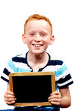 Young boy with chalkboard. Young boy laughing with chalkboard stock photo