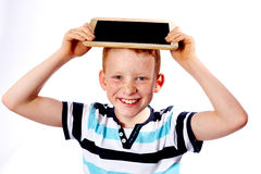 Young boy with chalkboard. Young boy laughing with chalkboard royalty free stock photography