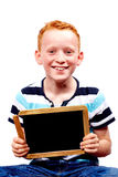 Young boy with chalkboard. Young boy laughing with chalkboard stock images