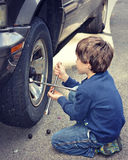 Young Boy Changing Tire Stock Photos
