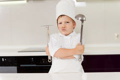 Young boy chef protecting his secret recipe Royalty Free Stock Images
