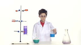 Young boy chemist wearing uniform, red shirt and stock footage