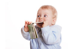 Young boy chew book. Wondering adorable young boy chew book Stock Photo