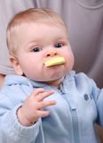 Young boy chew yellow toy. Adorable funny young boy chew his yellow toy Stock Photo