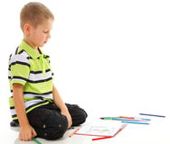 Young boy child draws with color pencils isolated Stock Photos