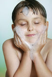 Young boy child washing cleansing face soap and water royalty free stock images