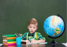 Young boy in classroom.  Royalty Free Stock Images