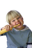 Young boy cleaning his teeth IV. An isolated picture of a young boy cleaning his teeth stock photos