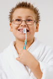 Young boy cleaning teeth Stock Image