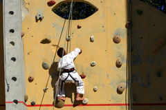 Young boy climbing. On a structure Royalty Free Stock Images
