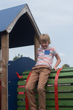 Young boy on climbing frame. Young male caucasian child on play equipment in playground royalty free stock images