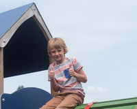 Young boy on climbing frame. Young male caucasian child on play equipment in playground stock photography