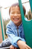 Young Boy On Climbing Frame In Playground Stock Photos