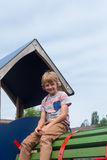 Young boy on climbing frame. Younf male caucasian child on play equipment in playground stock images