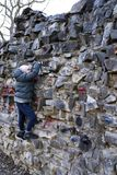 Young boy climbing up the wall stock image