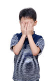 Young boy close his face by hands Stock Photography