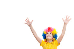 The young boy in clown wig hands up Royalty Free Stock Image
