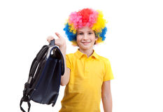 The young boy in clown wig with school satchel Royalty Free Stock Photos
