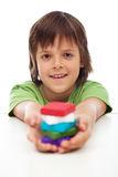 Young boy with colorful clay blocks in his hand Royalty Free Stock Photography