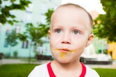 Young boy with colorful lollipop Royalty Free Stock Photos