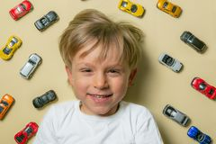 Young boy with colorful small car toys stock photos