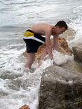 Young boy comes out from the Tyrrhenian sea Stock Photos