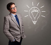Young boy comming up with a light bulb idea sign Stock Photos