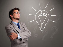 Young boy comming up with a light bulb idea sign Stock Image