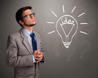 Young boy comming up with a light bulb idea sign Royalty Free Stock Photo