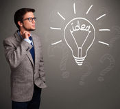 Young boy comming up with a light bulb idea sign Stock Photography