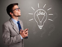 Young boy comming up with a light bulb idea sign Royalty Free Stock Photos