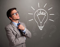 Young boy comming up with a light bulb idea sign Royalty Free Stock Photography