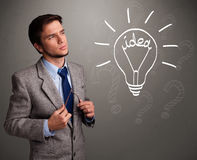 Young boy comming up with a light bulb idea sign Stock Images