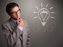 Young boy comming up with a light bulb idea sign Royalty Free Stock Image