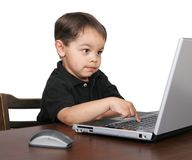 Young boy on computer Royalty Free Stock Photo