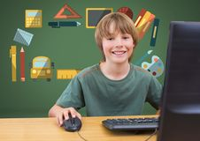 Young boy on computer with education graphic drawings Royalty Free Stock Images