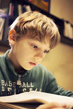 Young boy concentrating on homework Stock Photos