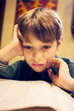 A young boy concentrating on homework. Royalty Free Stock Photography