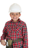 Young boy in a construction hardhat smiling Royalty Free Stock Image